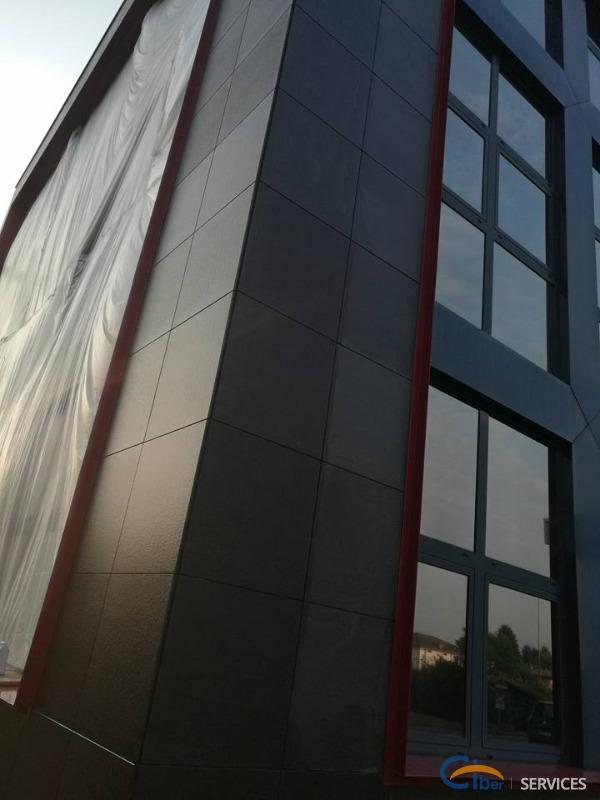 Protective and color enhancing anti-stain treatment on black granite facade